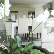 white flowers, dining table beyond. all white - dining room, floristry, flower, furniture, green, home, house, interior design, living room, plant, room, white