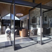 pointed timber roof, dark coloured fabrics in living door, window, gray