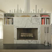 A mix of materials lends visual interest to fireplace, hearth, interior design, living room, orange, gray