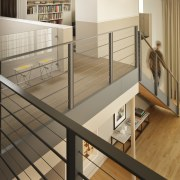 The metal balustrade in this apartment retains the floor, flooring, furniture, handrail, interior design, product, stairs, orange, brown