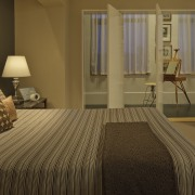 Swiveling panels allow natural light from the full-height bed, bed frame, bed sheet, bedroom, floor, flooring, hardwood, home, interior design, room, suite, window, wood, wood flooring, brown