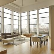 Architect David Hacin FAIA was immediately taken by ceiling, door, floor, flooring, interior design, living room, loft, window, brown, white