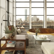 Furnishings were kept low-profile in this loft-style apartment home, interior design, living room, table, window, window covering, wood, white, brown