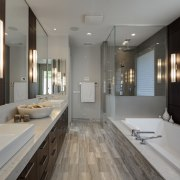 Greys and whites offset wooden floors and ceilings. bathroom, countertop, interior design, room, sink, gray