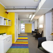 hallway featuring yellow walls and white ceilings from architecture, ceiling, interior design, office, real estate, room, gray