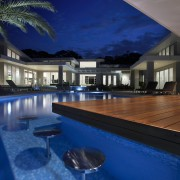This home's landscape was designed by Dean Herald apartment, architecture, estate, home, house, interior design, leisure, lighting, property, real estate, reflection, resort, resort town, swimming pool, villa, water, blue, black
