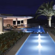 This home's landscape was designed by Dean Herald architecture, condominium, estate, home, house, interior design, landscape lighting, leisure, lighting, property, real estate, resort, swimming pool, villa, black, blue
