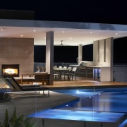 This home's landscape was designed by Dean Herald apartment, architecture, condominium, estate, home, house, interior design, lighting, property, real estate, reflection, swimming pool, black