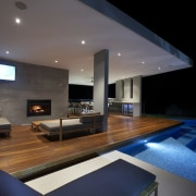 This home's landscape was designed by Dean Herald architecture, ceiling, daylighting, house, interior design, lighting, living room, real estate, black, gray