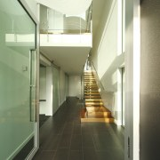 Hallway shot with stairs. - Hallway shot with architecture, ceiling, daylighting, floor, glass, handrail, house, interior design, lobby, stairs, green