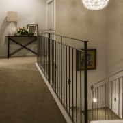 View of the top end of the stairs. baluster, ceiling, floor, flooring, handrail, home, house, interior design, iron, product, stairs, wood, brown