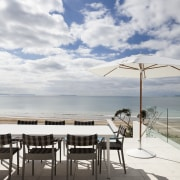 Outdoor living area with beachside. - Outdoor living cloud, horizon, sea, sky, table, vacation, water, gray