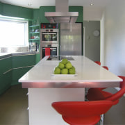 Table and red chairs in green kitchen. - countertop, interior design, kitchen, real estate, room, table, gray