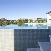 Overview of pool and stairs. - Overview of condominium, estate, home, house, leisure, property, real estate, resort, swimming pool, villa, teal