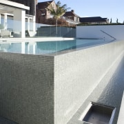 A nice view of the pool with a architecture, composite material, condominium, daylighting, facade, house, property, real estate, residential area, roof, swimming pool, wall, white