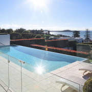 Sunny overlook of the pool. - Sunny overlook estate, house, leisure, leisure centre, property, real estate, resort, sky, swimming pool, villa, water, white, teal