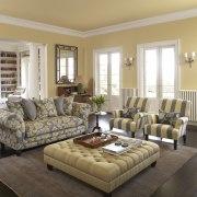 Open living area with unique fabrics. - Open bed frame, ceiling, couch, floor, flooring, furniture, hardwood, home, interior design, living room, room, window, window covering, window treatment, orange