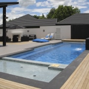 Overlook of pool with chairs. - Overlook of house, leisure, property, real estate, roof, swimming pool, water, gray