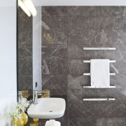 Chocolate-colored Manhattan marble features on the walls and bathroom, ceramic, floor, flooring, home, interior design, plumbing fixture, product design, room, sink, tap, tile, wall, white, gray