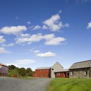 Architect Alexander Gorlin distilled the essence of a barn, cloud, cottage, estate, farm, farmhouse, field, grassland, home, house, land lot, landscape, property, real estate, residential area, rural area, sky, teal