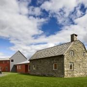 Architect Alexander Gorlin distilled the essence of a barn, building, cloud, cottage, croft, farm, farmhouse, grass, highland, home, house, property, real estate, rural area, sky, gray