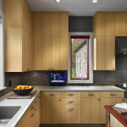 Architect Alexander Gorlin distilled the essence of a cabinetry, countertop, interior design, kitchen, real estate, room, brown