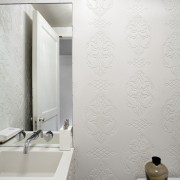 Custom-designed and fabricated Glacier White Corian clads every bathroom, bidet, ceramic, floor, flooring, interior design, plumbing fixture, product design, room, tap, tile, wall, wallpaper, white