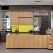Above left: A vibrant yellow splashback provides a cabinetry, countertop, furniture, interior design, kitchen, gray