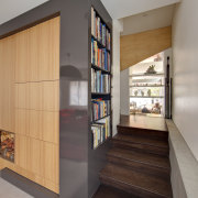The view from the front door of this bookcase, furniture, interior design, shelf, shelving, gray
