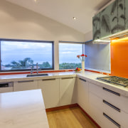 This kitchen was designed and built by Mal countertop, interior design, kitchen, real estate, orange