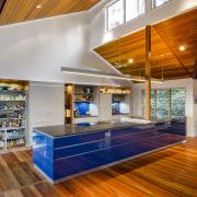This kitchen was designed by Kim Duffin of architecture, ceiling, daylighting, floor, flooring, hardwood, house, interior design, laminate flooring, living room, lobby, loft, real estate, wood, wood flooring, orange, gray