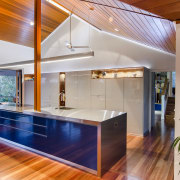 This kitchen is open to the view on architecture, ceiling, daylighting, estate, hardwood, home, house, interior design, kitchen, real estate, wood, gray