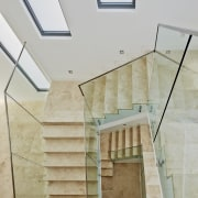 Marble staircase with glass balustrade by Starr Constructions architecture, ceiling, daylighting, estate, floor, handrail, home, house, interior design, property, real estate, stairs, gray
