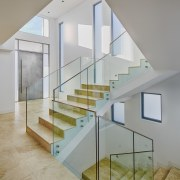 This home was designed and built by Starr architecture, baluster, daylighting, floor, glass, handrail, home, house, interior design, real estate, stairs, wall, gray