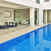 Pool of contemporary family home by Starr Constructions apartment, estate, leisure, leisure centre, property, real estate, swimming pool, orange, teal