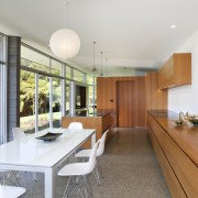 A view of the kitchen and dining areas.A house, interior design, real estate, white