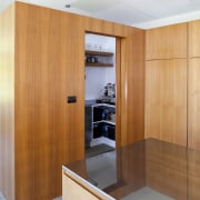 A sliding scullery door closes off any cooking cabinetry, interior design, kitchen, wood, orange, white