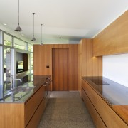 Polished stainless steel countertops and teak veneer cabinetry architecture, countertop, house, interior design, kitchen, real estate, wood, white