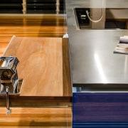 This kitchen was designed by Kim Duffin of countertop, floor, flooring, furniture, hardwood, interior design, kitchen, table, wood, wood flooring, wood stain, orange