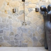 Various shapes and types of stone add texture floor, flooring, plumbing fixture, tile, wall, gray, white