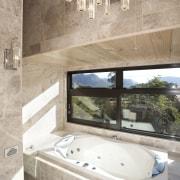 This bathroom in a Lockwood home features a architecture, bathroom, bathtub, estate, floor, flooring, home, interior design, property, room, tile, gray