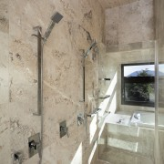A thick glass door and a window are architecture, bathroom, ceiling, floor, room, tile, wall, gray