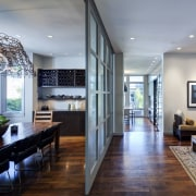 Sliding steel and glass panels separate the dining ceiling, house, interior design, living room, real estate, gray