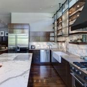 A black steel hood contrasts white calacatta marble cabinetry, countertop, cuisine classique, interior design, kitchen, gray, black
