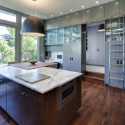 Layered kitchen by Nicholas Design Collaborative with marble cabinetry, countertop, hardwood, interior design, kitchen, real estate, room, gray
