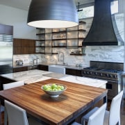 The breakfast bar is an extension of the chair, countertop, dining room, interior design, kitchen, table, gray