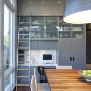 This layered kitchen features sliding stainless steel and countertop, interior design, kitchen, gray