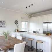 A view of the kitchen and dining areas. countertop, home, interior design, kitchen, property, real estate, room, gray, white