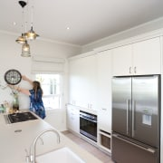 A close up view of the kitchen area. ceiling, countertop, home, interior design, kitchen, room, white