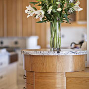 A close up view of the kitchen cabinetry flowerpot, furniture, home, interior design, table, wood, orange, brown